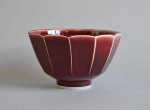 Facetted copper red bowl