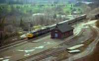 Railpictures.ca - A.W.Mooney Photo:   Here is an angle photographers seldom bothered with at the old Dundas station. But, it was worth a try. It is around the noon hour that VIA #72 eastward passes, so I hiked up into the hill and cleaned out some brush to wait for it. Standard train. Power 6781 and 6865. It was worth it. History recorded.|Railpictures.ca – Canadian Railway Photography – photographie ferroviaire Canadienne.