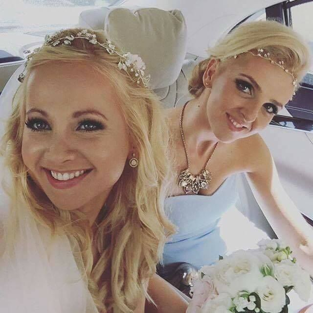 Decolove Bride wearing Northern Lights Bridal Tiara and her bridesmaid with matching Headpiece