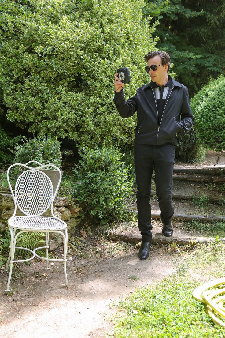 blouson en coton noir polo en maille de viscose noir empiècement jacquard blanc pantalon 5 poches en coton noir