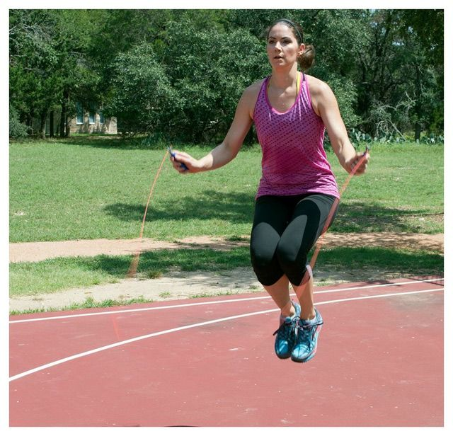 Blast 100 calories fast with this jump rope routine: Backward Hops