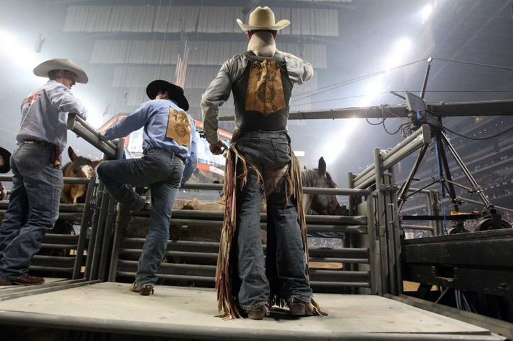 (Center) Evan Jayne looks out into the stadium as he gets ready to compete in Bareback Riding during the BP Super Series III Round 2 at Reliant Stadium on Monday, March 4, 2013, in Houston.    Photo By Mayra Beltran/Houston Chronicle