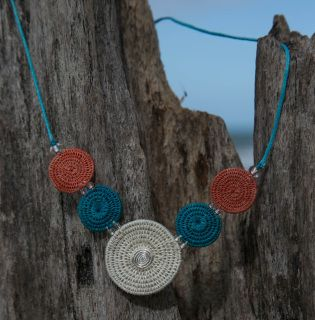 Bringing the feel of the beach to your every day. This eye catching short necklace is made using traditional African basket weaving technique. The jewellery is hand woven from sisal, an invasive weed in Swaziland.  Slip through coconut button clasp.  Find out more about Tintsaba...