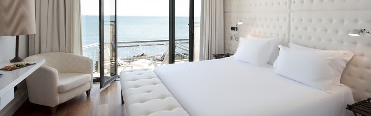 Perched on an outcrop of rock a few feet from the Atlantic Ocean, Farol Design Hotel marries a traditional Portuguese villa with a modern wing.