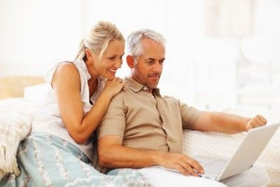 middle-aged couples using online marriage counseling