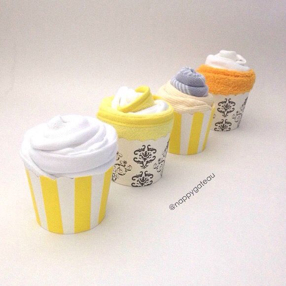baby shower cupcakes made of baby essentials for a neutral gender baby shower