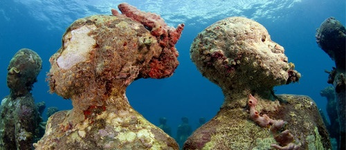 Jason deCaires Taylor submerges his work—predominantly human figures—in the waters of the West Indies and in the Gulf of Mexico. Over time, the permanent installations come to act as artificial reefs, attracting corals, aggregating fish species, and increasing marine biomass. Most of Taylor's figures stand with their faces upturned to the surface, their eyes closed, as they are silently and arrestingly overtaken by algae, sponges, and hydrozoans.