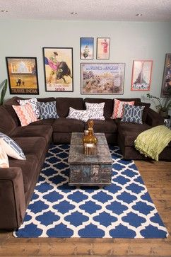 A gallery wall, plush brown sectional, and mix of patterns keep this family room fun and functional. The Surya Frontier rug adds a global touch with it's lattice pattern. From Decorating Den Interiors- Decorate with Kate. (FT-84)