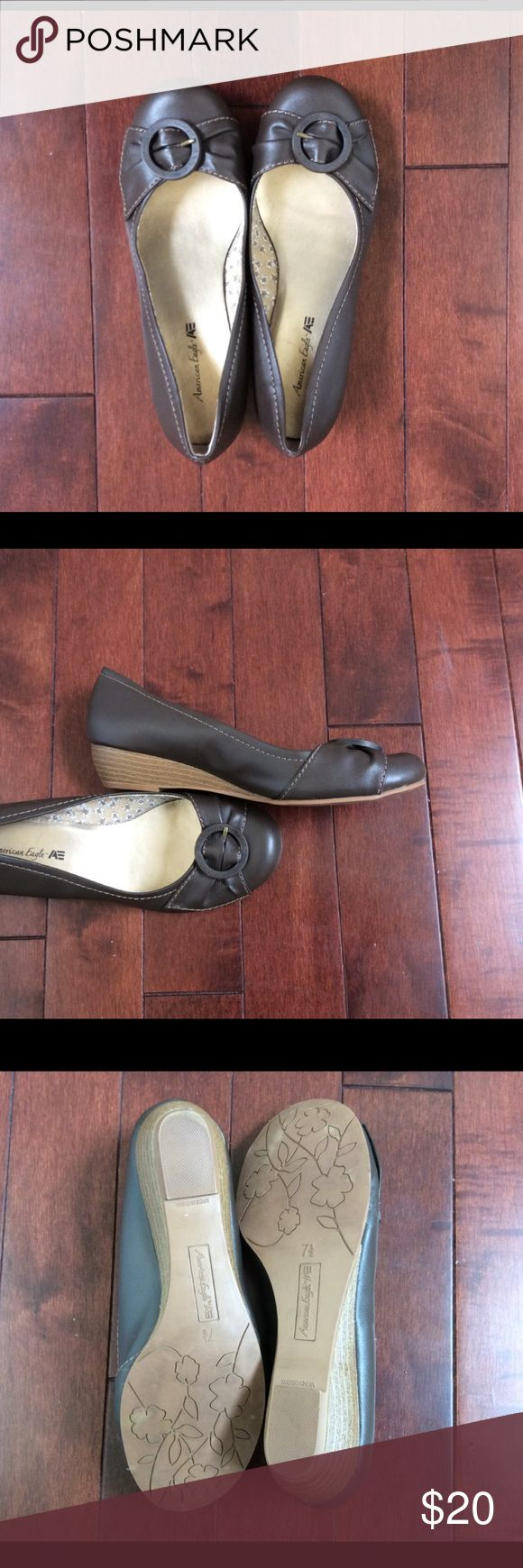 American Eagle Brown Wedges Adorable brown low wedges from American Eagle in size 7.5.  Barely used at all!  Rounded toe with buckle detail.  1 inch wedge heel.  Perfect for a casual day at the office or to wear on a day out!  Comfortable and classically stylish :) American Eagle Outfitters Shoes Wedges