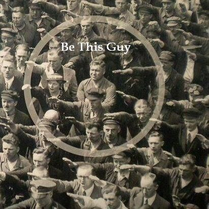 SO AWESOME! It was Nazi Germany in 1936, and a crowd of people had gathered in Hamburg to watch the launch of a navy training vessel. As hundreds raised their arms in unison in the Nazi salute, one man stood with his arms crossed, his eyes squinting at whoever was leading the salute.It was not until 1991 that the man was identified as August Landmesser, a worker at the Blohm + Voss shipyard in Hamburg, by one of his children, after she saw the photo in a German newspaper.