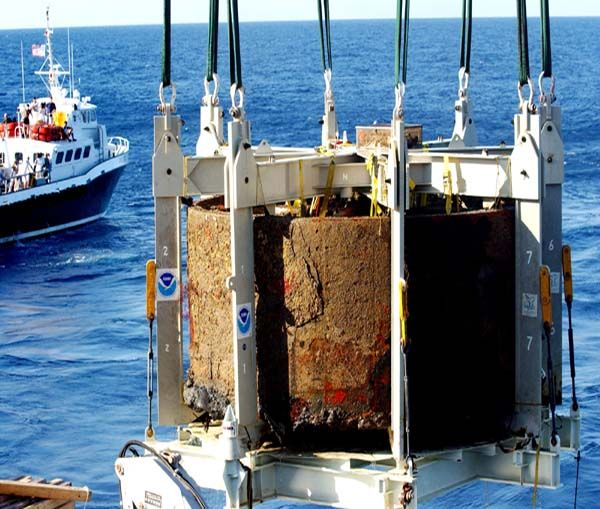 USS Monitor gun turret being recovered from the depths of the Atlantic Ocean. Now being conserved at the Mariner's Museum in Newport News, VA