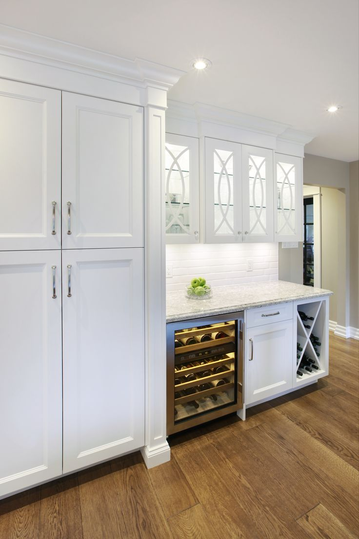 PERIMETER    White painted custom cabinetry complete with ...