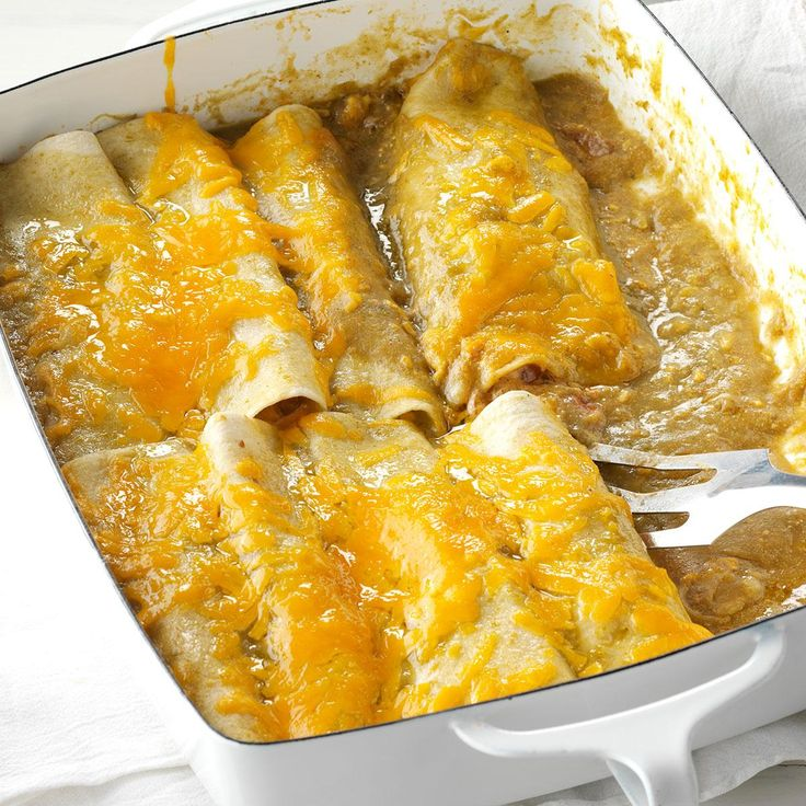 Onion & Green Chili Enchiladas Recipe -When we have guests, they lobby for my infamous enchiladas. I usually make a meatless version, but feel free to add cooked chicken if you want to include a protein. —Anthony Bolton, Bellevue, Nebraska