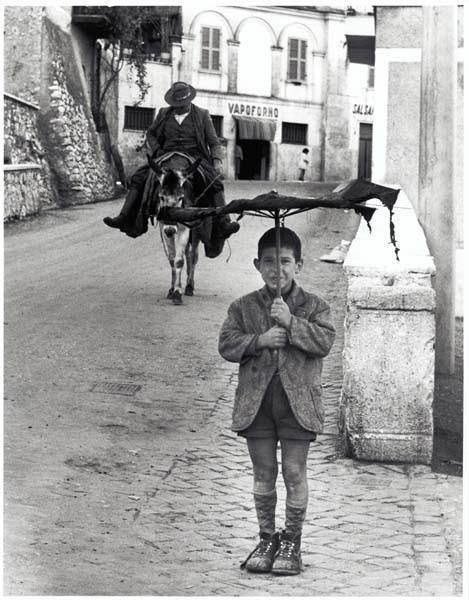 "Italy.  The ""Umbrella Boy"", Rome 1958 // photo by Bill Perlmutter"