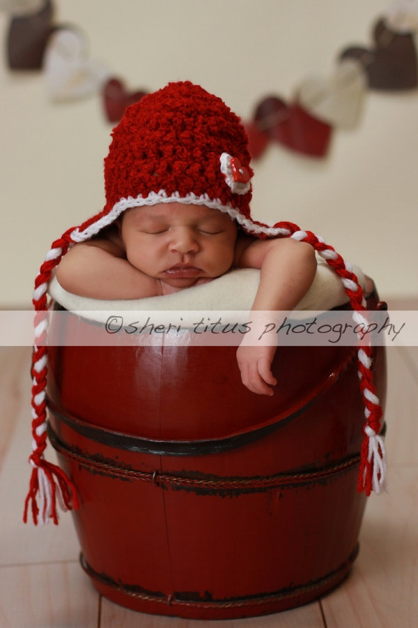 Red And White Earflap Hat with Braids Baby Hat           Baby Photo Prop with Heart Button. via Etsy.
