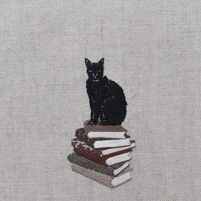 """Did you know H. P. Lovecraft had a black cat he named """"Nigger-man""""? ⠀⠀⠀⠀⠀⠀⠀⠀⠀ Racist or a mere product of his time? Viewing history through a modern prism often proves unsettling. ⠀⠀⠀⠀⠀⠀⠀⠀⠀ Those familiar with his writings would have stumbled upon more definitive examples. He had a fascinating life, albeit torturous. ⠀⠀⠀⠀⠀⠀⠀⠀⠀ Hand embroidery on natural linen. ⠀⠀⠀⠀⠀⠀⠀⠀⠀ #lovecraft #embroidery #books"""