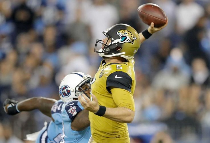 Thursday Night Football: Jaguars vs. Titans:    October 27, 2016  -  36-22, Titans   -    Blake Bortles #5 of the Jacksonville Jaguars passes the ball while being pressured by Jurrell Casey #99 of the Tennessee Titans during the first quarter of a game at Nissan Stadium on Oct. 27, 2016 in Nashville.