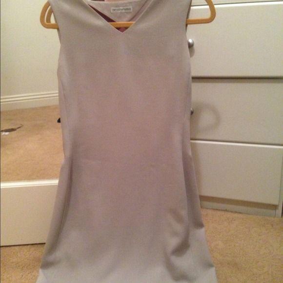 Emporio Armani dress! Classy Emperio Armani dress. Open back it fits size4. Dresses