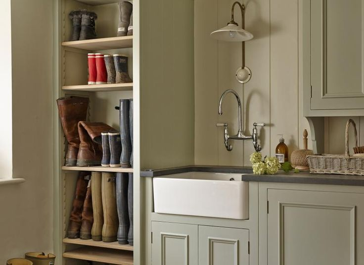 Traditional utility room with painted cupboards