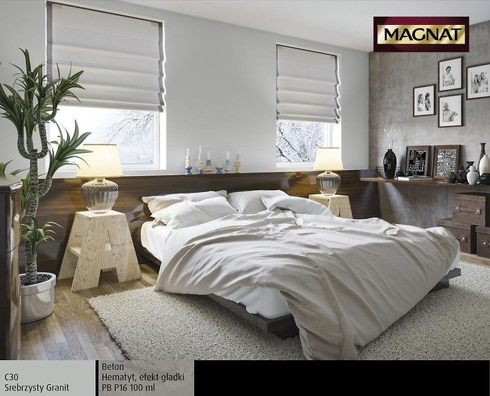 Sypialnia w miejskim stylu utrzymana w kolorach szarości ocieplonych delikatnym beżem. Chłodna, betonowa, minimalistyczna, ale wyjątkowo przytulna dzięki wyposażeniu i dodatkom takim jak duże drewniane łóżko, nowoczesne szafki nocne, lampki z płóciennymi abażurami, galeria rodzinnych zdjęć.