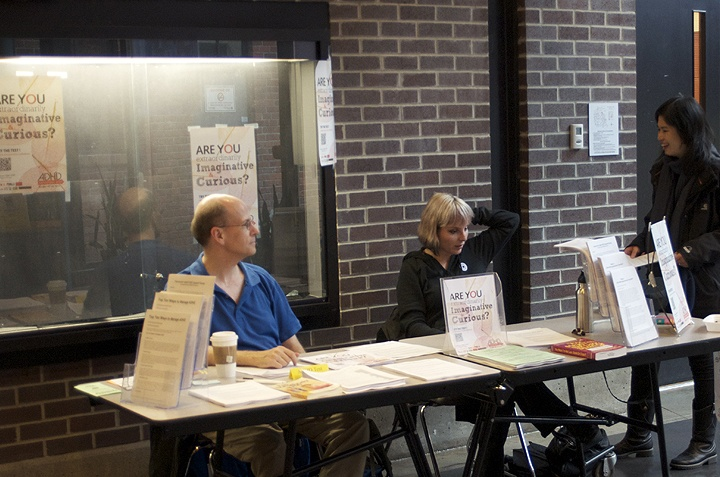 ADHD Awareness Week 2012 Info Table at The Roundhouse Community Center, Vancouver BC. The Vancouver Adult ADD Support Group. Pete & Jade Staffing Table, Maggie visiting. Photo by Kevin, Maggie's Husband