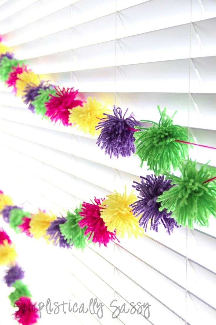 How to make a Yarn Pom-Pom Garland/Streamer  could be a cute group activity for girl scout groups, they could make a strand then take it with them to hang