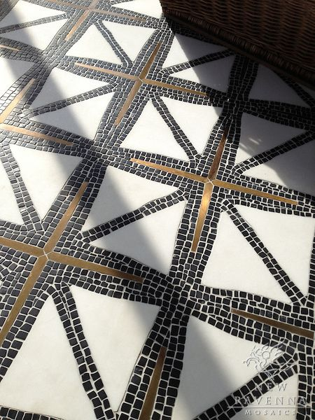 Indus stone waterjet mosaic in tumbled Nero Marquina, honed Thassos, and bronze inlay | James Duncan for New Ravenna