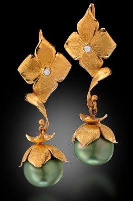Diamond, pearl and gold earrings.