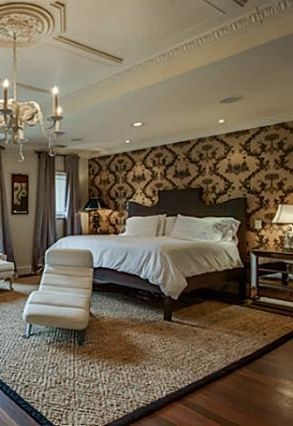 Love the wallpapered wall behind the master bed