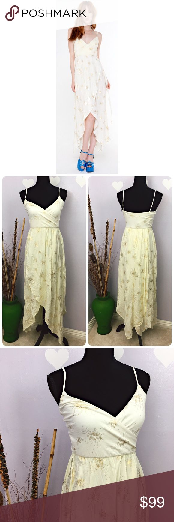 Novella Royale Peny Gold Lilly Dress Free People Brand New Novella Royale Penny Gold Lilly Dress Size label M Nonadjustable spaghetti strap with paneled handkerchief skirt.  Style NR13PEN  100% rayon  Made in USA   Length approx: 28 Novella Royale Dresses Asymmetrical