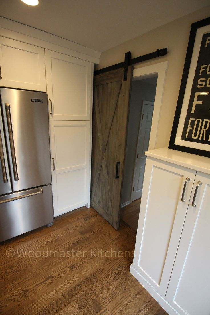 Creative the way the door slides into the cabinet...similar to a pocket door.