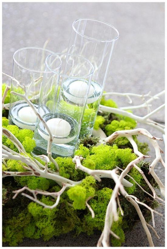 www.mossfinefloral.com  Wedding Centerpiece for an outdoor wedding. Moss, Manzanita and candles.