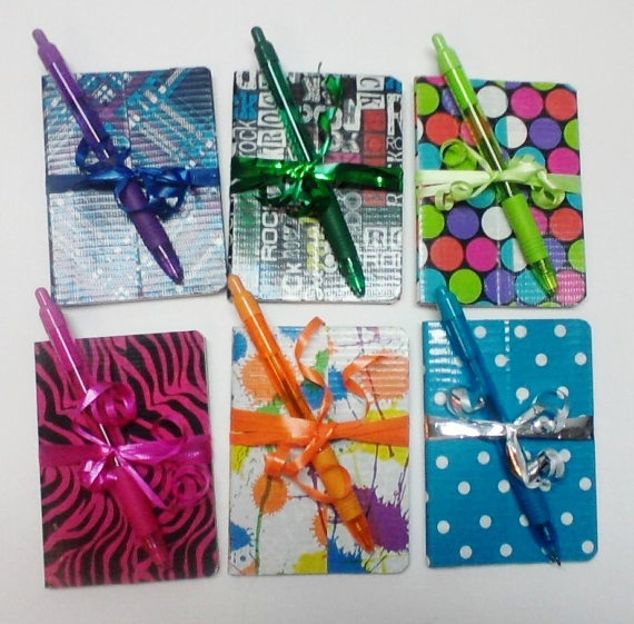 Cover a cheap notebook from the dollar store with cute duct tape. Get a matching pen and tie it all together with a ribbon. Cute for a gift!