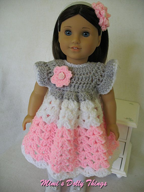 Crocheted doll clothes for 18 inch dolls including American girl. Dress Pink, grey and white with head band