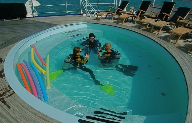 Learning to Dive in the pool onboard a Superyacht