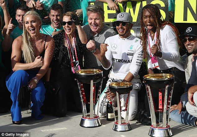 Hamilton (2nd right) celebrates his win with Williams (right), Gordon Ramsey (centre) and Lindsey Vonn (left)