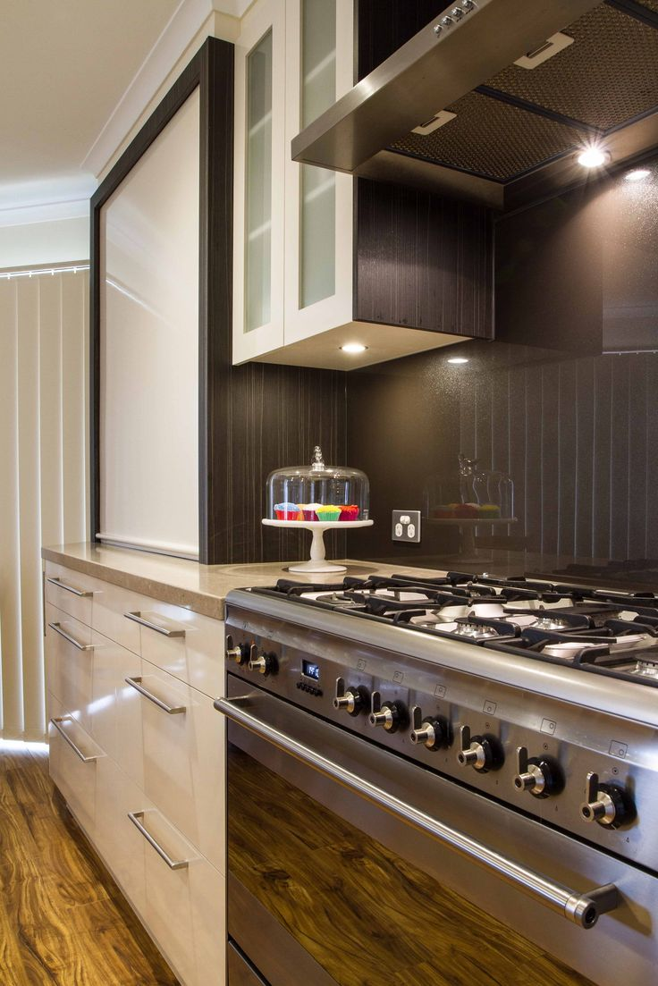 Contemporary, two-toned kitchen. Appliance pantry and 900 oven with exposed rangehood. www.thekitchendesigncentre.com.au