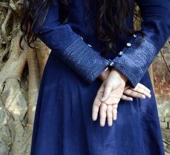 Silver zari work on sleeves on indigo kurta