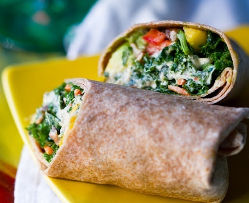 Whole grain wrap with lettuce and other veggies, can be mixed with grilled chicken, turkey and salmon.