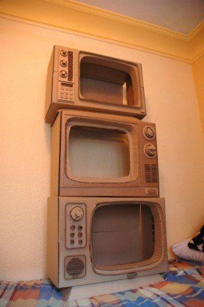 One cardboard tv can set the stage for a child to star on their tv show.  The tv could sit on a table with a table cloth.
