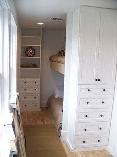 "kids' rooms - I would ""turn"" the built-in so that the doors/drawers opened on the left side into the aisle to save that wall space for something else"