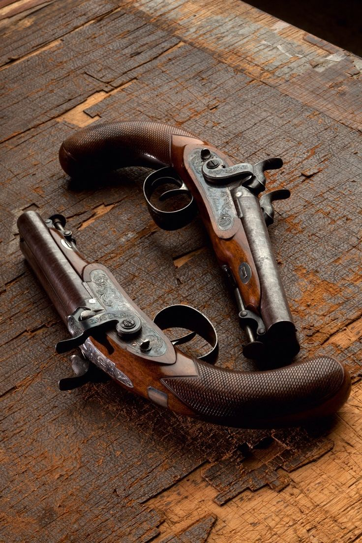 A pair of double-barrel cap lock pistols