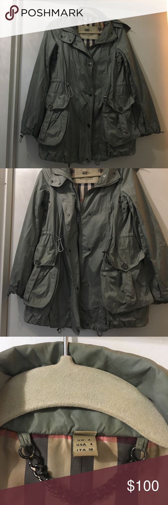 Burberry Rain Coat Women's rain coat, size 4. Small tear in right underarm (picture 4) that can easily be repaired. No major stains or other tears. Smoke free/pet free home. Burberry Jackets & Coats Utility Jackets