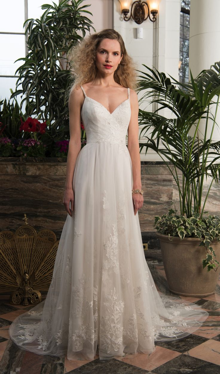 Flora, Chloe Bridals. Fitted lace and tulle cross over bodice, V-neckline bodice with shoestring straps crossing over to deep back, soft flowing tulle and lace skirt with train. #wedding #dress