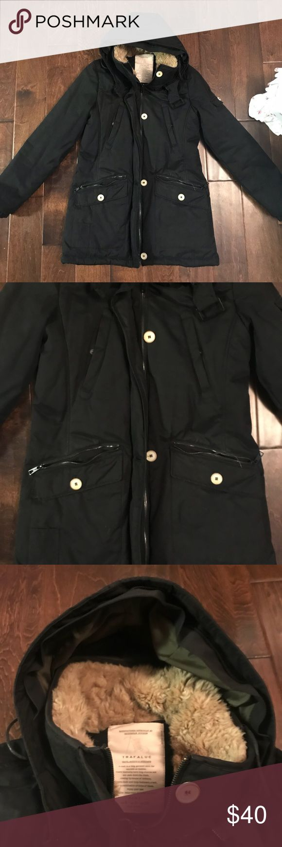 Zara black winter coat Zara winter coat. It has been use years ago but I'm great condition. It had a fitting hood with a high zip neck with a furry inside. The jacket material is night a sturdy and doesn't let wing through. It has for outside pockets and two inside pockets. Nice button details and the slate button is inside. Zara Jackets & Coats