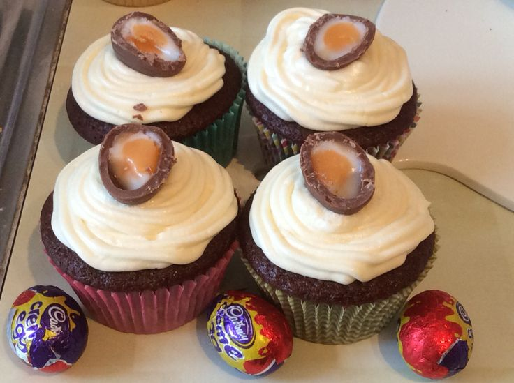 Creme egg cupcakes filled with vanilla buttercream (to give the look of a Cadbury creme egg once cut into)