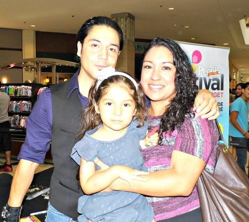 Husband and wife: Chris Perez and Vanessa Villanueva with their daughter
