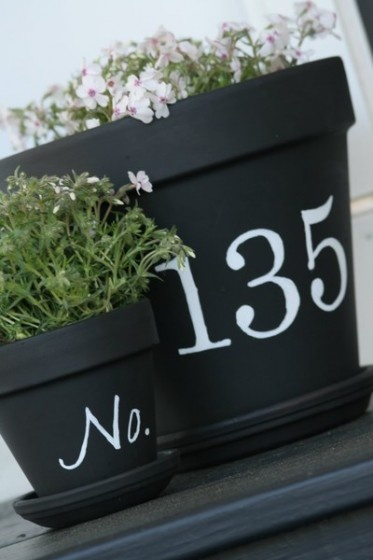Blackboard painted terracotta pots. Lovely idea, and much nicer than terracotta orange.