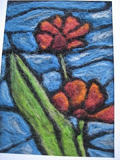 Stained glass needle felting some of my eailer work.
