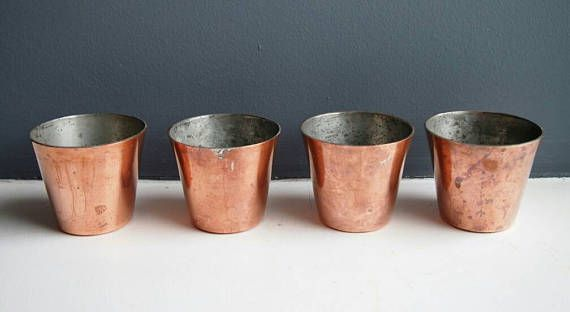 Check out this item in my Etsy shop https://www.etsy.com/uk/listing/520038604/4-small-vintage-round-copper-cake-moulds